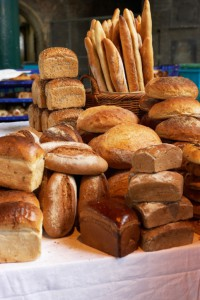 Various loaves piled on market stall